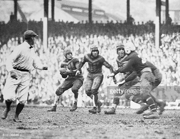 The New York Giants vs the Chicago Bears at the Polo Grounds in this photo Red Grange is shown at left about to make a pass
