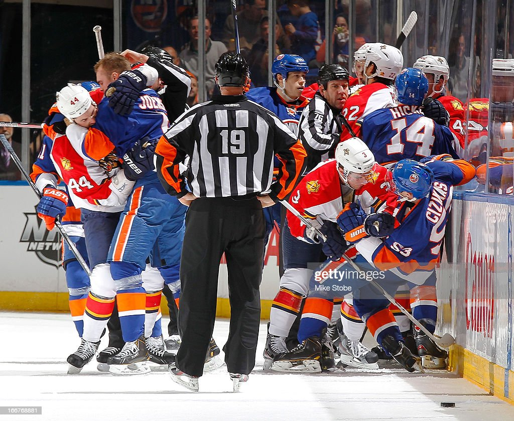 The New York Islanders and Florida Panthers mix it up during the first period at Nassau Veterans Memorial Coliseum on April 16, 2013 in Uniondale, New York.