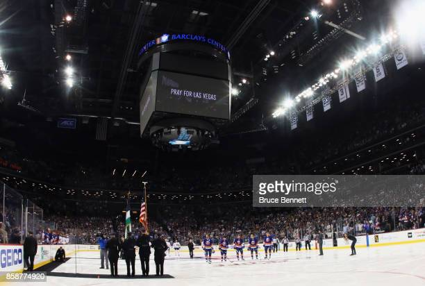 The New York Islanders and the Buffalo Sabres hold a moment of silence for Las Vegas prior to their game at the Barclays Center on October 7 2017 in...