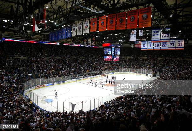 The New York Islanders and the Buffalo Sabres stand for the national anthem prior to their game on April 16, 2007 at Nassau Coliseum in Uniondale,...