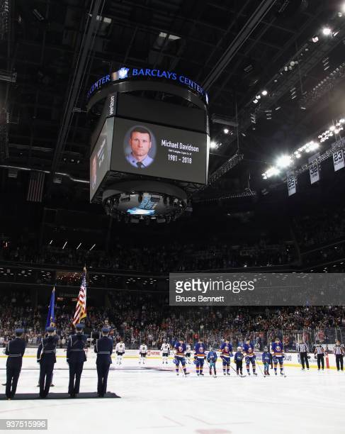 The New York Islanders and the Chicago Blackhawks stand for a moment of silence for FDNY memeber Michael Davidson prior to their game at the Barclays...
