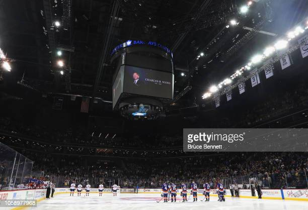 The New York Islanders and the Florida Panthers stand at attention during a pregame moment of silence for Islanders owner Charles Wang at the...