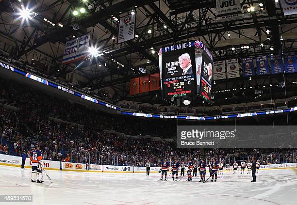 The New York Islanders and the Philadelphia Flyers observe a moment of silence for long time NHL coach and executive Pat Quinn prior to their game at...