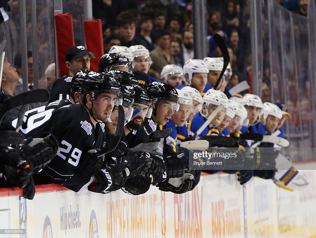 The New York Islanders and the St. Louis Blues watch the shootout at the Barclays Center on December 4, 2015 in Brooklyn borough of New York City.
