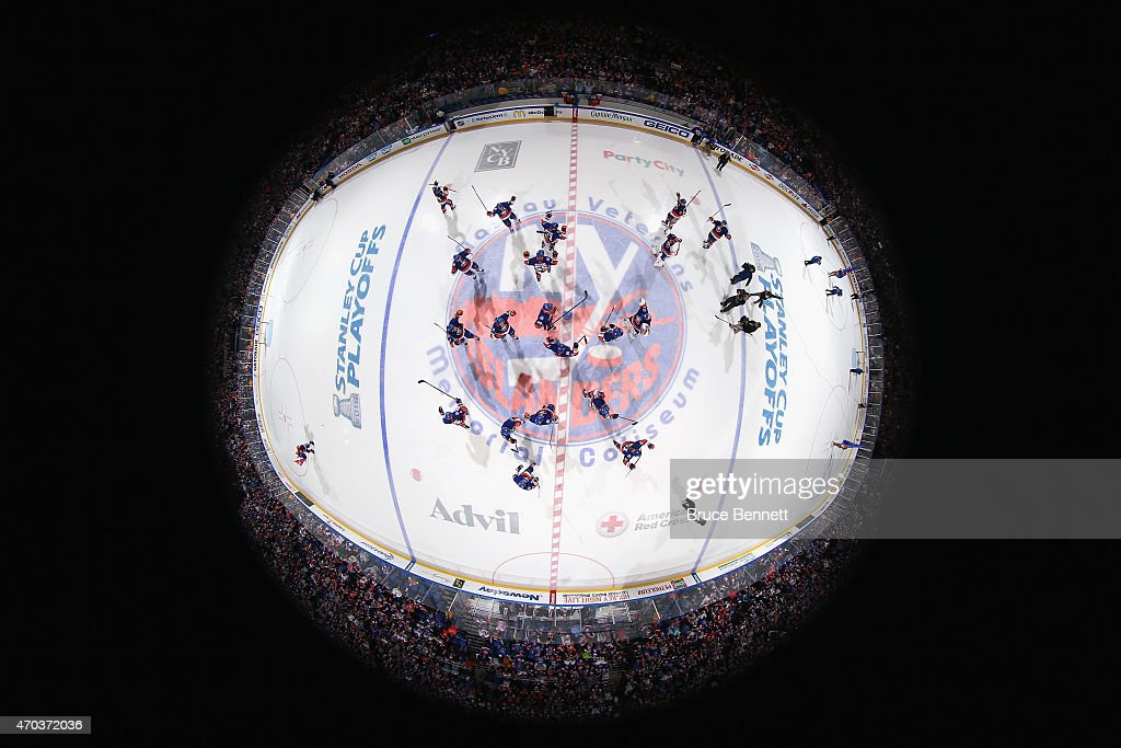 The New York Islanders celebrate a 2-1 overtime victory against the Washington Capitals in Game Three of the Eastern Conference Quarterfinals during the 2015 NHL Stanley Cup Playoffs at the Nassau Veterans Memorial Coliseum on April 19, 2015 in Uniondale, New York.