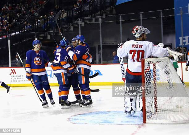The New York Islanders celebrate a goal by Andrew Ladd against Braden Holtby of the Washington Capitals at 36 seconds of the second period at the...