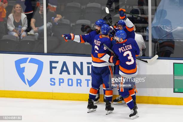 The New York Islanders celebrate a goal by Mathew Barzal against the Tampa Bay Lightning during the second period in Game Four of the Stanley Cup...