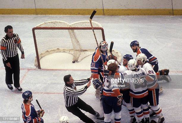 The New York Islanders celebrate a goal during the 1984 Stanley Cup Finals against the Edmonton Oilers in May 1984 at the Nassau Coliseum in...