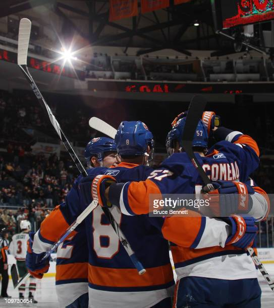 The New York Islanders celebrate a second period goal by Blake Comeau against the Minnesota Wild at the Nassau Coliseum on March 2 2011 in Uniondale...