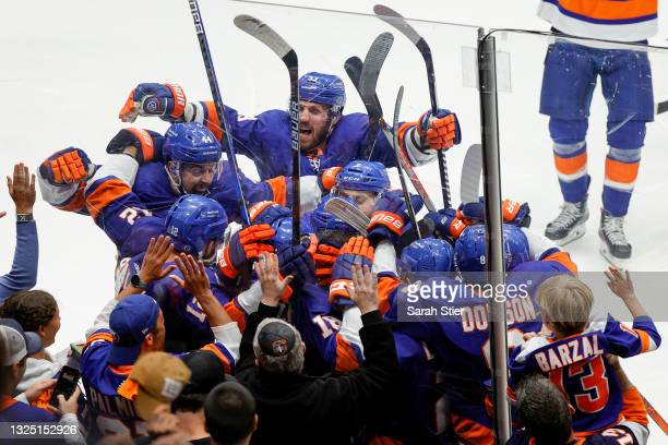 The New York Islanders celebrate after their 3-2 overtime victory against the Tampa Bay Lightning in Game Six of the Stanley Cup Semifinals during...