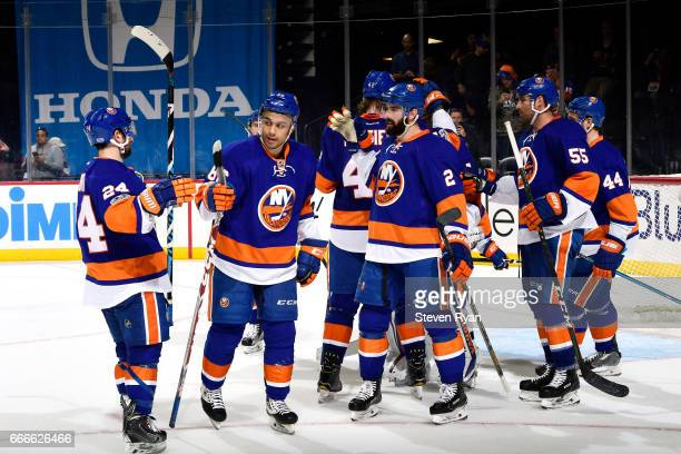The New York Islanders celebrate their 42 victory over the Ottawa Senators after an NHL game at Barclays Center on April 9 2017 in New York City