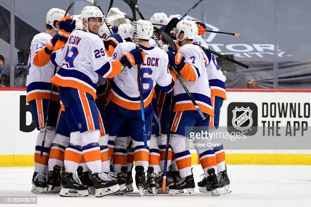 The New York Islanders celebrate their 4-3 win over the Pittsburgh Penguins during overtime in Game One of the First Round of the 2021 Stanley Cup...
