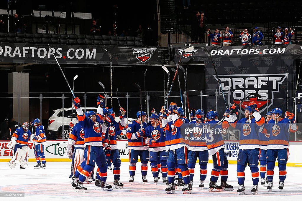The New York Islanders celebrate their win after the game against the Calgary Flames at the Barclays Center on October 26, 2015 in Brooklyn borough of New York City. The Islanders defeated the Flames 4-0.