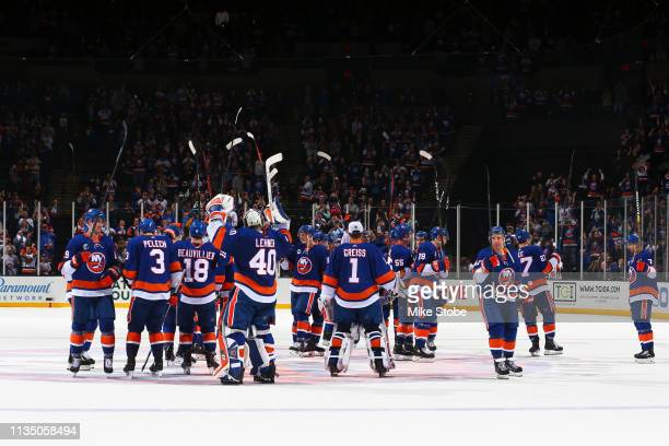 The New York Islanders celebrates after defeating the Buffalo Sabres 5-1 to clinch a play-off berth at NYCB Live's Nassau Coliseum on March 30, 2019...