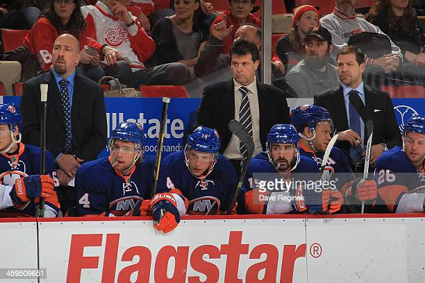 The New York Islanders coaches from L to R assistant coach Brent Thompson head coach Jack Capuano and assistant coach Doug Weight watch the action...