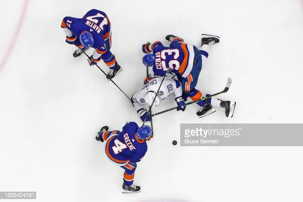 The New York Islanders defend against Blake Coleman of the Tampa Bay Lightning in Game Six of the NHL Stanley Cup Semifinals during the 2021 NHL...