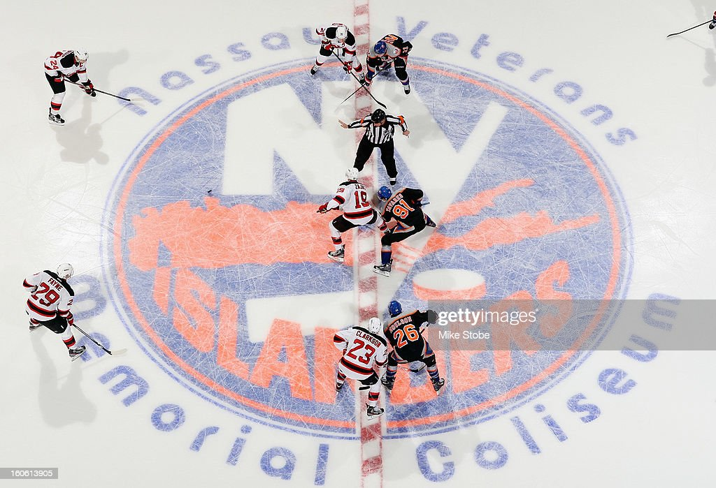 The New York Islanders face-off against the New Jersey Devils at Nassau Veterans Memorial Coliseum on February 3, 2013 in Uniondale, New York. The Devils defeat the Islanders 3-0.