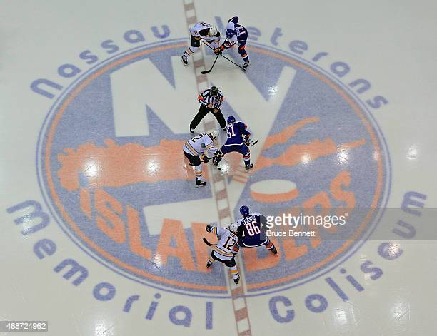 The New York Islanders faceoff aginst the Buffalo Sabres at the Nassau Veterans Memorial Coliseum on April 4, 2015 in Uniondale, New York. The...