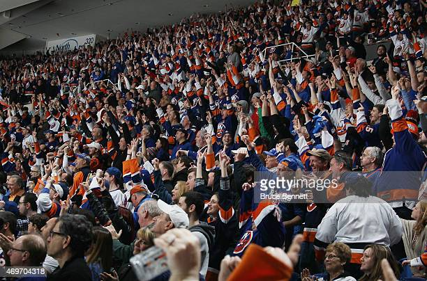 """The New York Islanders fans chant their signature """"Yes, Yes, Yes"""" following a goal by Kyle Okposo against the Columbus Blue Jackets at the Nassau..."""