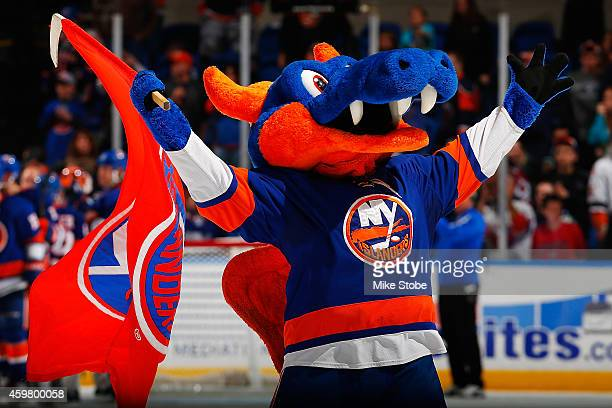 The New York Islanders mascot Sparky celebrates after the teams victory against the Colorado Avalanche at Nassau Veterans Memorial Coliseum on...