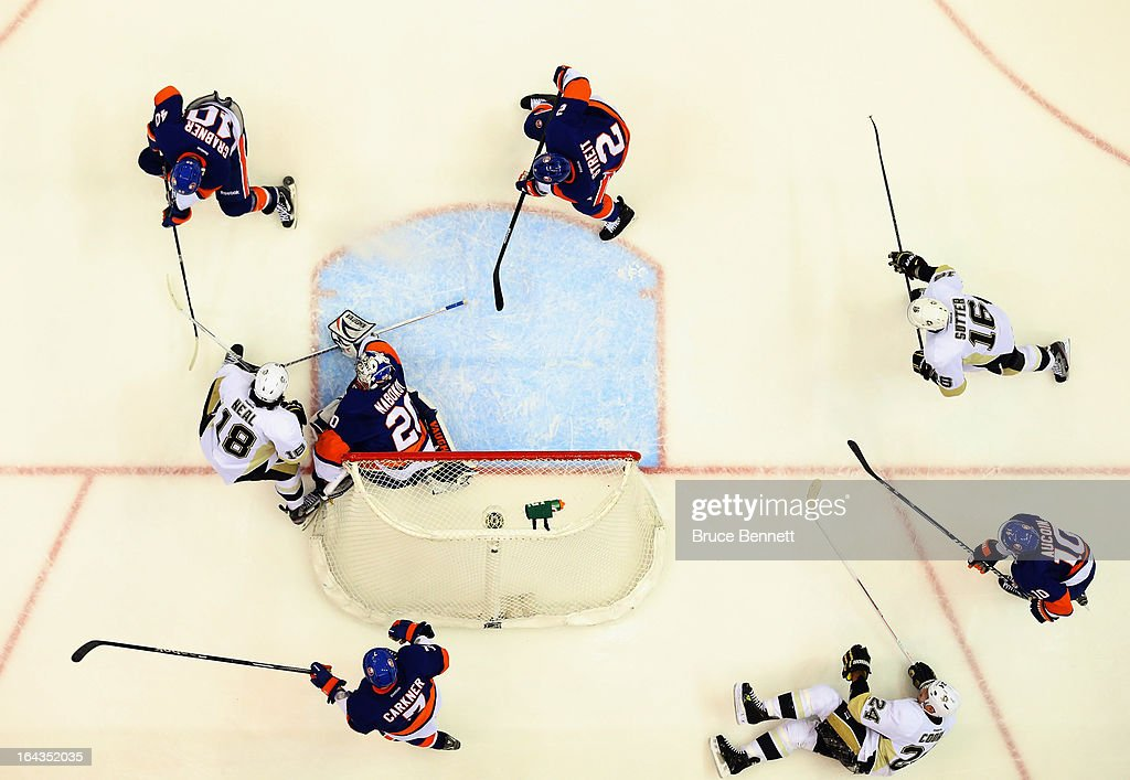 The New York Islanders play against the Pittsburgh Penguins at Nassau Veterans Memorial Coliseum on March 22, 2013 in Uniondale, New York. The Penguins defeated the Islanders 4-2.