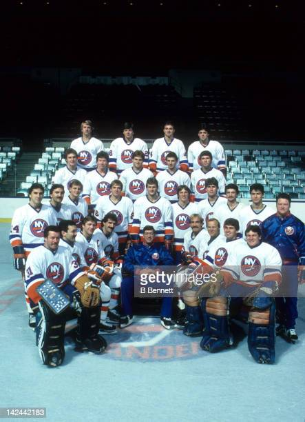 The New York Islanders pose for a group team photo around head coach Al Arbour in October, 1984 at the Nassau Coliseum in Uniondale, New York.