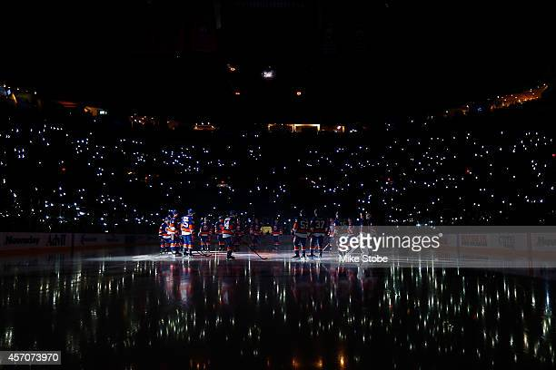 The New York Islanders salute the crowd prior to the home opener against the Carolina Hurricanes at Nassau Veterans Memorial Coliseum on October 11,...