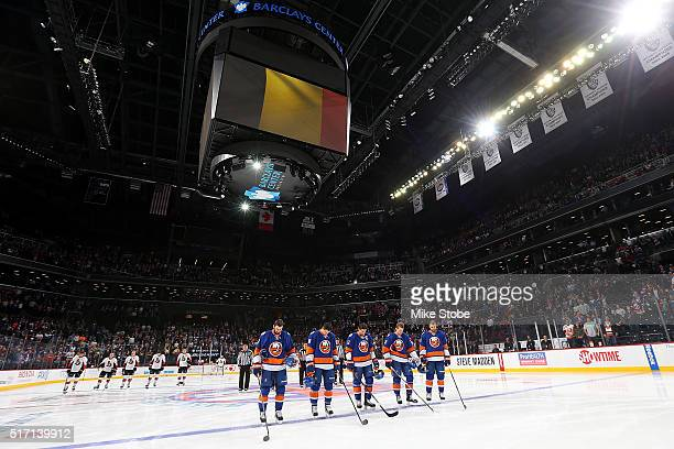 The New York Islanders stand during a moment of silence to honor the victims of the recent terrorist attacks in Belgium prior to the game against the...