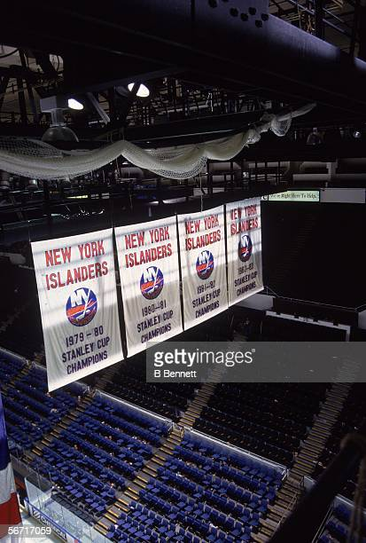 The New York Islanders' Stanley Cup Championship banners hang from the rafters at the Nassau Coliseum, Uniondale, New York, late 20th Century.