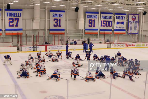 The New York Islanders stretch after a scrimmage at Northwell Health Ice Center at Eisenhower Park on January 10, 2021 in East Meadow, New York.