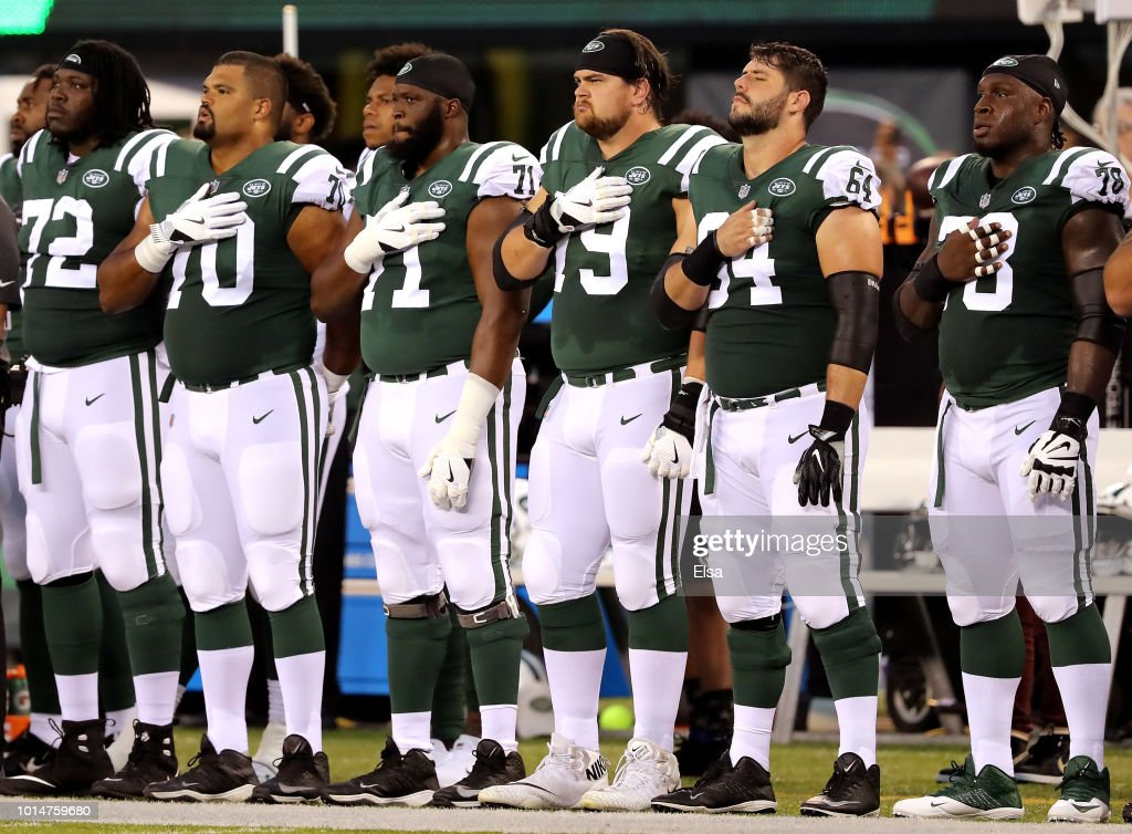 The New York Jets bench lines up for the national anthem before the game against the Atlanta Falcons during a preseason game at MetLife Stadium on August 10, 2018 in East Rutherford, New Jersey.