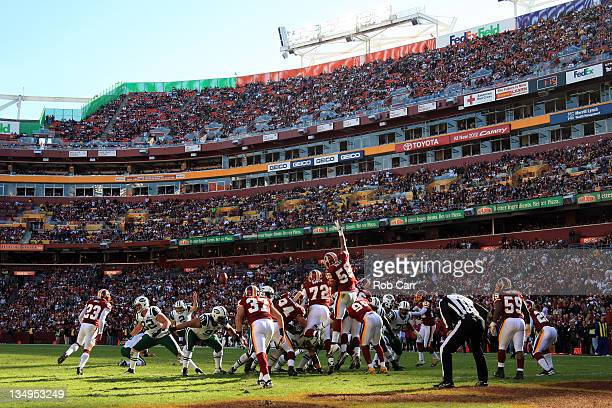 The New York Jets kick an extra point against the Washington Redskins at FedExField on December 4 2011 in Landover Maryland