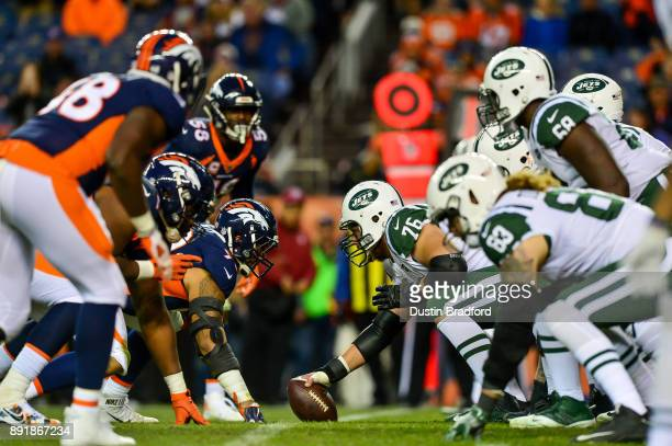 The New York Jets offense lines up behind Wesley Johnson against the Denver Broncos at Sports Authority Field at Mile High on December 10 2017 in...