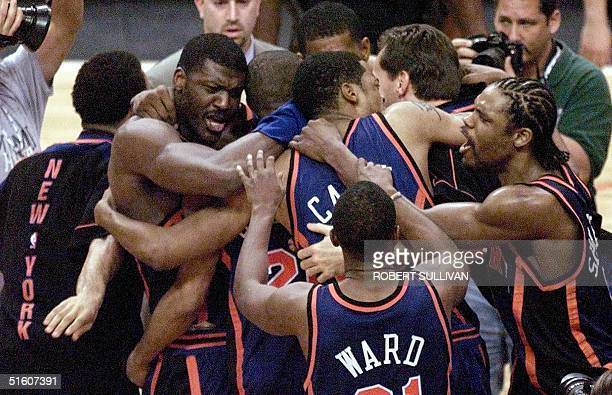 The New York Knicks celebrate their lastsecond victory over the Miami Heat 16 May 1999 during game five of their first round playoff game at the...