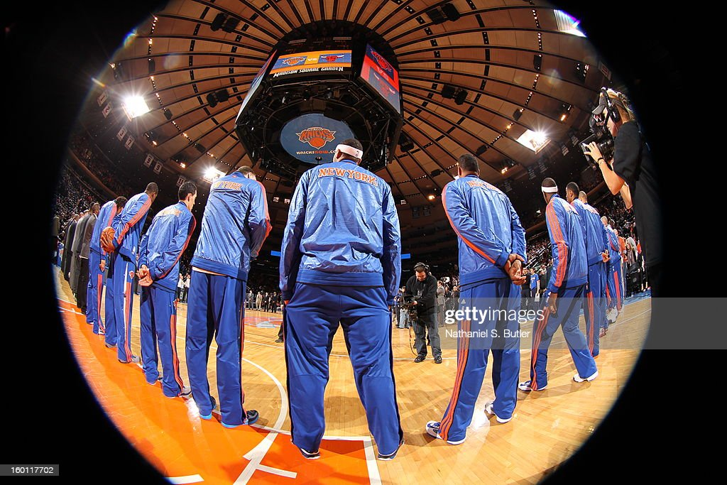 The New York Knicks stand for the national anthem before the game against the Chicago Bulls on January 11, 2013 at Madison Square Garden in New York City.