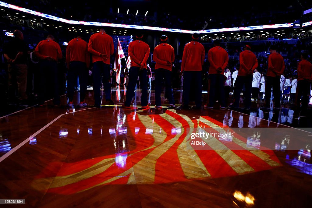The New York Knicks stand for the National Anthem during their game against the Brooklyn Nets at the Barclays Center on December 11, 2012 in the Brooklyn borough of New York City.