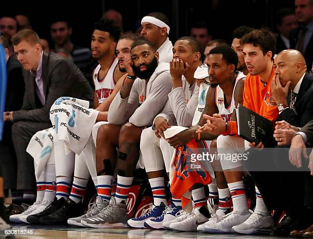 The New York Knicks starters look on from the bench in the final minutes of the fourth quarter against the Orlando Magic at Madison Square Garden on...