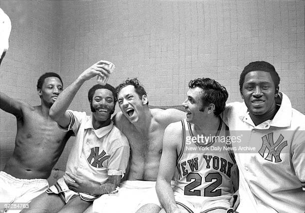 The New York Knicks' starting five Dick Barnett Walt Frasier Bill Bradley Dave DeBusschere and Willis Reed rejoice in the dressing room after winning...