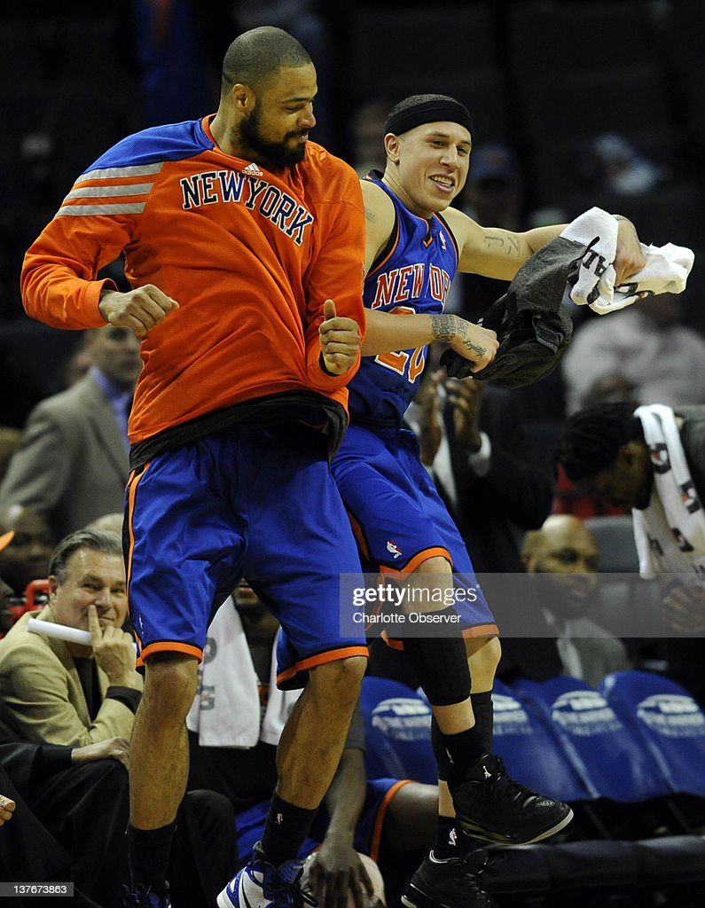 The New York Knicks' Tyson Chandler, left, and Mike Bibby celebrate amid a 111-78 romp over the Charlotte Bobcats at Time Warner Cable Arena in Charlotte, North Carolina, on Tuesday, January 24, 2012.