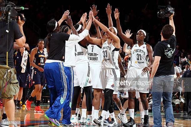 The New York Liberty celebrate after a game against the Connecticut Sun at Madison Square Garden in New York City on June 29 2014 NOTE TO USER User...