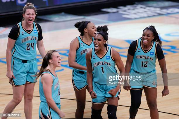 The New York Liberty celebrate after Sabrina Ionescu made a three-point basket in the final seconds of the second half against the Indiana Fever at...