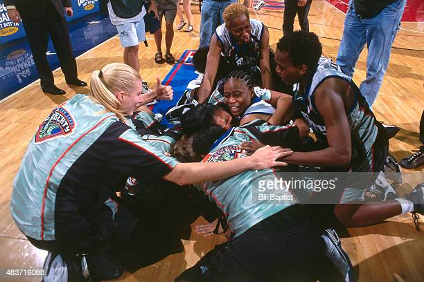 The New York Liberty celebrate after Teresa Weatherspoon makes a 50 foot buzzer beater against the Houston Comets in Game 2 of the 1999 WNBA Finals...