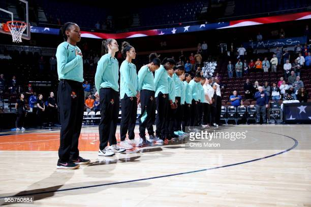 the New York Liberty look on for the national anthem prior to the preseason game against the Dallas Wings on May 7 2018 at Mohegan Sun Arena in...