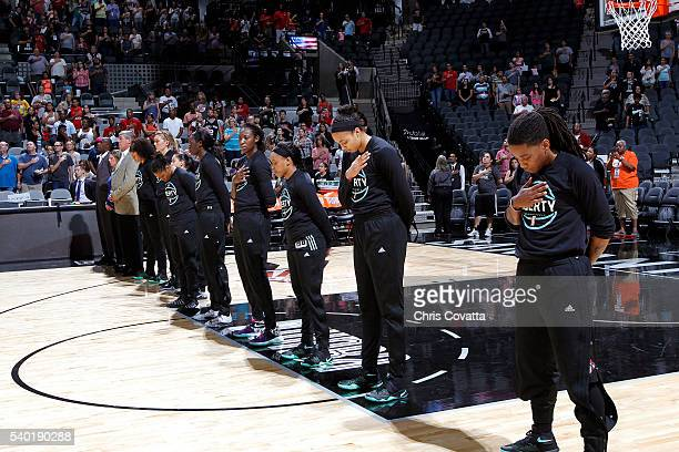 The New York Liberty stand for a moment of silence for the national anthem before the game against the San Antonio Stars on June 11 2016 at the ATT...