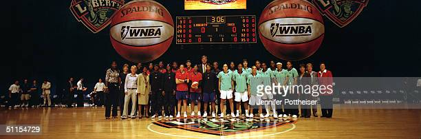 The New York Liberty team and the Detroit Shock team pose for a portrait during the inaugural WNBA game at Radio City Music Hall on July 24 2004 in...