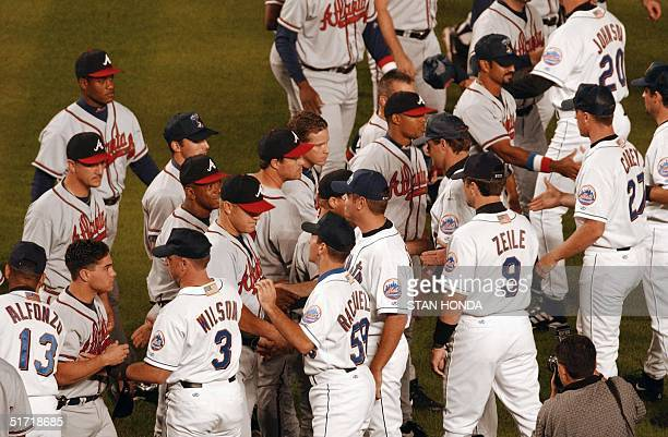The New York Mets and Atlanta Braves exchange greetings before the game 21 September 2001 at Shea Stadium in New York as the Mets play their first...