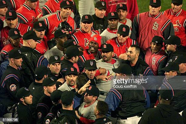The New York Mets and St Louis Cardinals swarm the field after Mets Jay Payton was hit by a pitch from St Louis Cardinals pitcher Dave Veres in the...