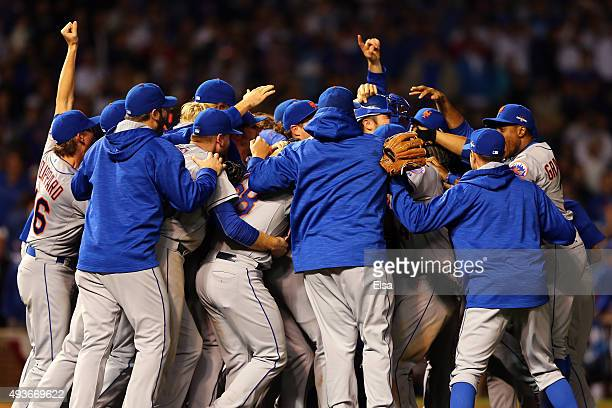 The New York Mets celebrate after defeating the Chicago Cubs in game four of the 2015 MLB National League Championship Series at Wrigley Field on...