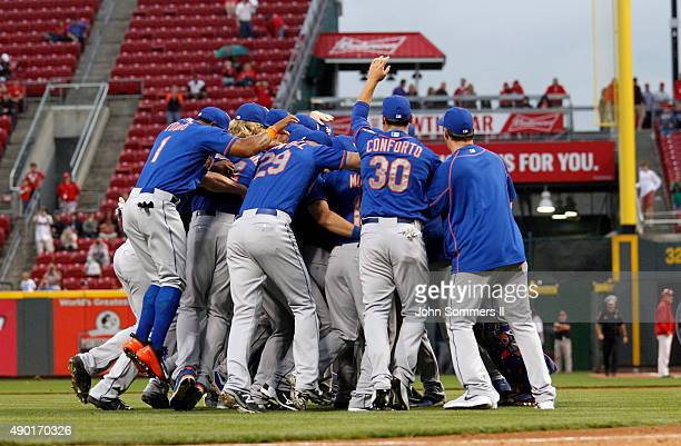 The New York Mets celebrate after defeating the Cincinnati Reds 102 to clinch the National League East Championship at Great American Ball Park on...