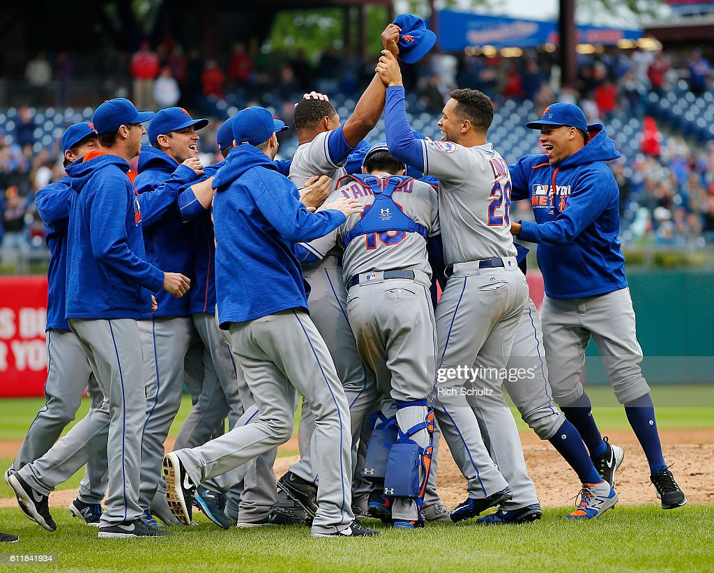 The New York Mets celebrate after defeating the Philadelphia Phillies 5-3 during a game at Citizens Bank Park on October 1, 2016 in Philadelphia, Pennsylvania. The win puts the Mets into the Wild card playoffs.